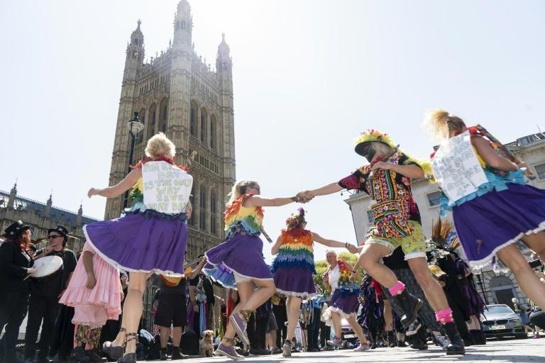 A number of morris dancing teams joined the protest outside Parliament (AFP Photo/Niklas HALLE'N)