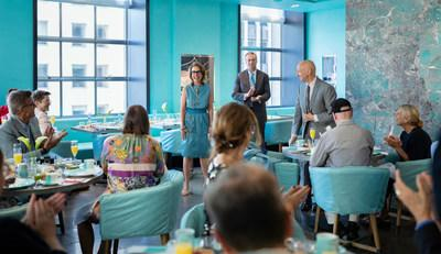 Rose Marie Bravo, Vice Chairman of Burberry, in Tiffany's Blue Box Cafe on 5th Avenue in Manhattan, New York City, introducing British Milliner Stephen Jones OBE to guests, the day before Cunard's 2019 Queen Mary 2 Transatlantic Fashion Week at Sea