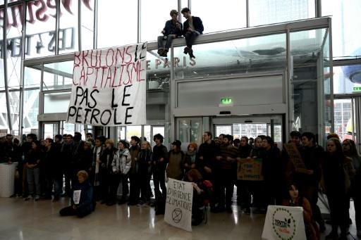 Activists formed a human chain to protest Black Friday sales at a shoping mall in the La Defense business district west of Paris, France, on Friday