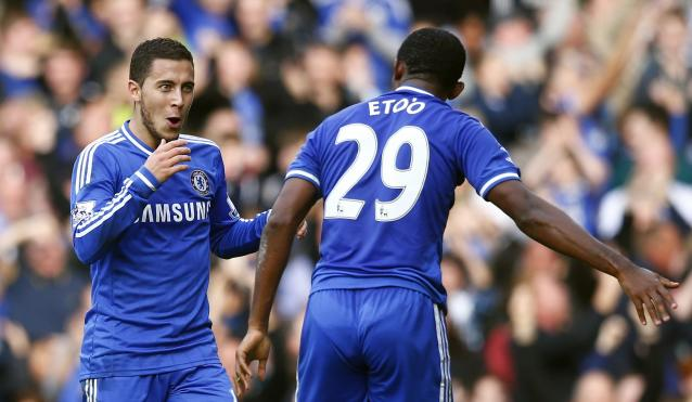 "Chelsea's Eden Hazard celebrates with Samuel Eto'o (R) after scoring against Cardiff City during their English Premier League soccer match at Stamford Bridge in London, October 19, 2013. REUTERS/Andrew Winning (BRITAIN - Tags: SPORT SOCCER) NO USE WITH UNAUTHORIZED AUDIO, VIDEO, DATA, FIXTURE LISTS, CLUB/LEAGUE LOGOS OR ""LIVE"" SERVICES. ONLINE IN-MATCH USE LIMITED TO 45 IMAGES, NO VIDEO EMULATION. NO USE IN BETTING, GAMES OR SINGLE CLUB/LEAGUE/PLAYER PUBLICATIONS. FOR EDITORIAL USE ONLY. NOT FOR SALE FOR MARKETING OR ADVERTISING CAMPAIGNS"