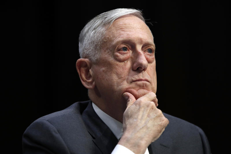 "FILE - In this April 26, 2018, file photo, Defense Secretary Jim Mattis listens to a question during a hearing on Capitol Hill in Washington. Mattis warns bitter political divisions have pushed American society to the ""breaking point"" in his most extensive public remarks since he resigned in protest from the Trump administration.  (AP Photo/Jacquelyn Martin, File)"