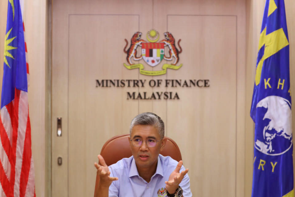 Minister of Finance Datuk Seri Tengku Zafrul Abdul Aziz stated that the balance in the Trust account will be used to repay and service 1MDB and SRC's remaining debts. — Reuters pic