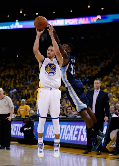 OAKLAND, CA - MAY 03: Stephen Curry #30 of the Golden State Warriors shoots over Jeff Green #32 of the Memphis Grizzlies during Game One of the Western Conference Semifinals during the NBA Playoffs on May 3, 2015 at Oracle Arena in Oakland, California. NOTE TO USER: User expressly acknowledges and agrees that, by downloading and or using this photograph, User is consenting to the terms and conditions of the Getty Images License Agreement. (Photo by Ezra Shaw/Getty Images)