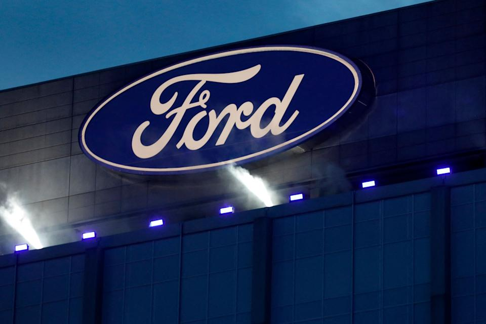 Ford Motor Company' logo is seen on the side of the building at the unveiling of their new electric F-150 Lightning outside of their headquarters in Dearborn, Michigan on May 19, 2021. - One day after winning an enthusiastic endorsement from President Joe Biden, Ford will officially preview the all-electric version of its best-selling F-150 truck on May 19, 2021. The battery-powered Ford F-150