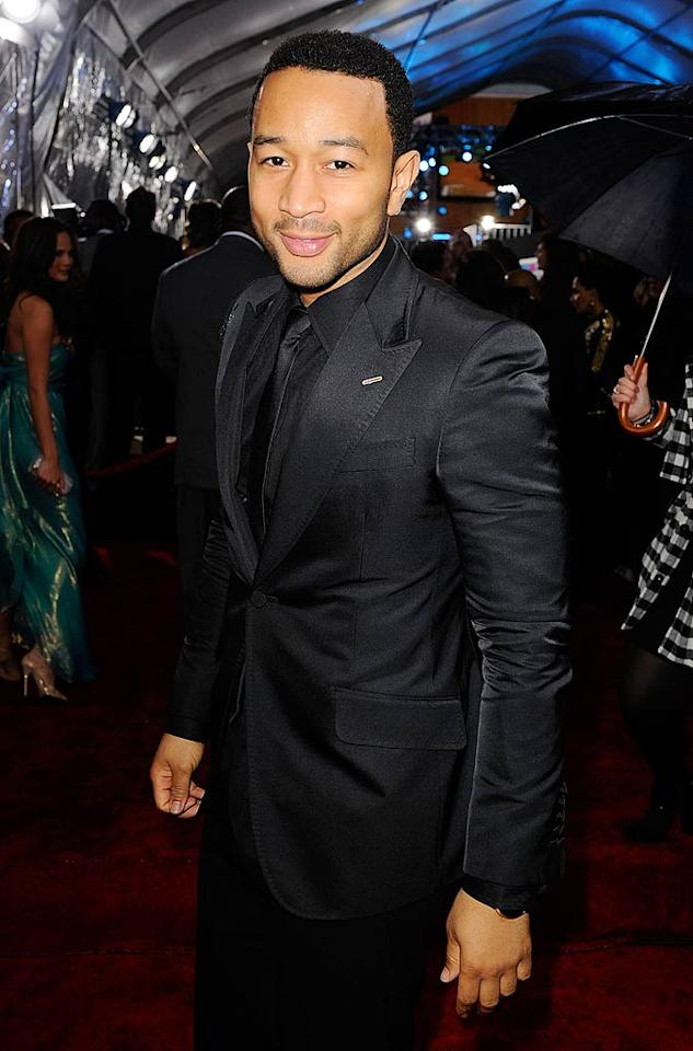 John Legend arrives at the 2011 American Music Awards held at the Nokia Theatre L.A. LIVE. (11/20/2011)