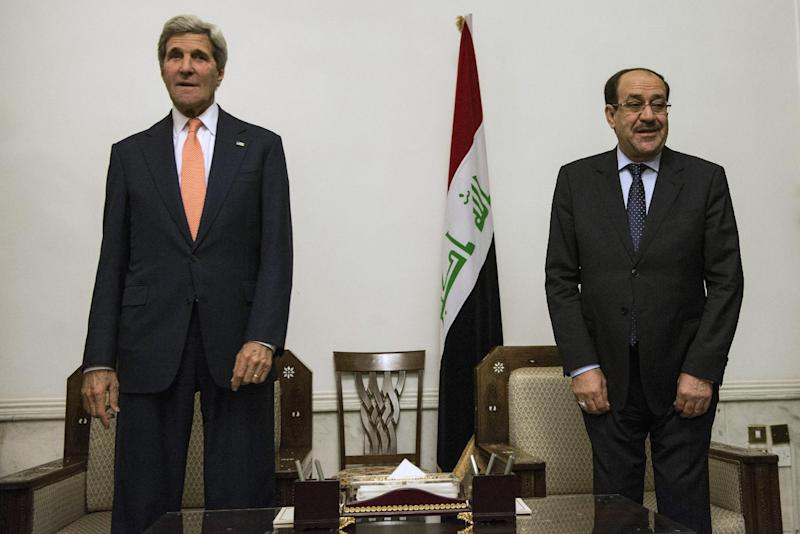 Nuri al-Maliki (right) and US Secretary of State John Kerry meet at the Prime Minister's Office in Baghdad on June 23, 2014 (AFP Photo/Brendan Smialowski)