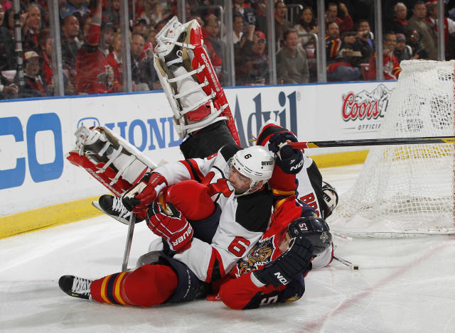SUNRISE, FL - APRIL 15: Marcel Goc #57 of the Florida Panthers runs into Andy Greene #6 as goaltender Martin Brodeur #30 of the New Jersey Devils also falls to the ice in Game Two of the Eastern Conference Quarterfinals during the 2012 NHL Stanley Cup Playoffs at the BankAtlantic Center on April 15, 2012 in Sunrise, Florida. (Photo by Joel Auerbach/Getty Images)