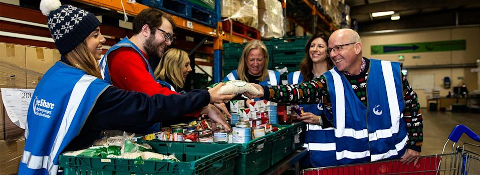 Three tonnes of food donated to the Trussell Trust and Fareshare redistribution services by Tesco shoppers this Christmas. Photo: Tesco