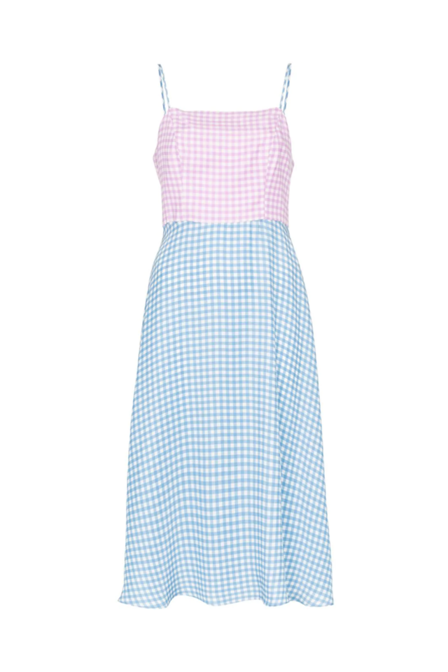 "<p><strong>HVN</strong></p><p>farfetch.com</p><p><strong>$266.00</strong></p><p><a href=""https://www.farfetch.com/shopping/women/hvn-nora-contrast-gingham-print-silk-midi-dress-item-13501194.aspx"" target=""_blank"">SHOP IT</a></p><p>Sweet like cotton candy is how I would describe this flare slip dress from HVN. The silky material embodies the lightness and ease of summer and the item can be layered over a t-shirt or button-up for that extra fashion-girl spin. </p>"