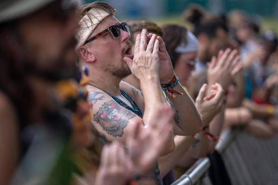 Fans cheer as John Moreland performs at the Railbird Festival at Keeneland in Lexington on Aug. 28. Fans had to show proof of vaccination or a negative test to get in but were not required to wear a mask.