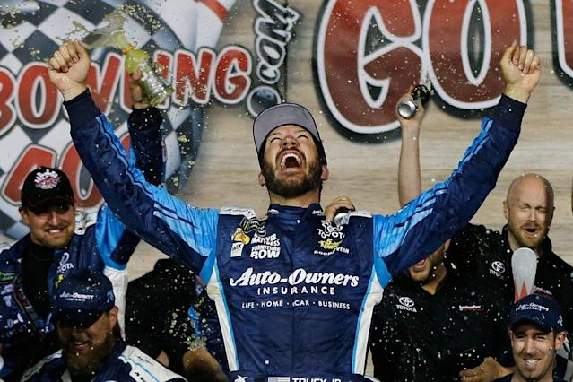 "<a class=""link rapid-noclick-resp"" href=""/nascar/sprint/drivers/380/"" data-ylk=""slk:Martin Truex Jr"">Martin Truex Jr</a>. celebrates in Victory Lane after winning the Monster Energy NASCAR Cup Series Go Bowling 400 at Kansas Speedway. (Photo by Jonathan Ferrey/Getty Images)"