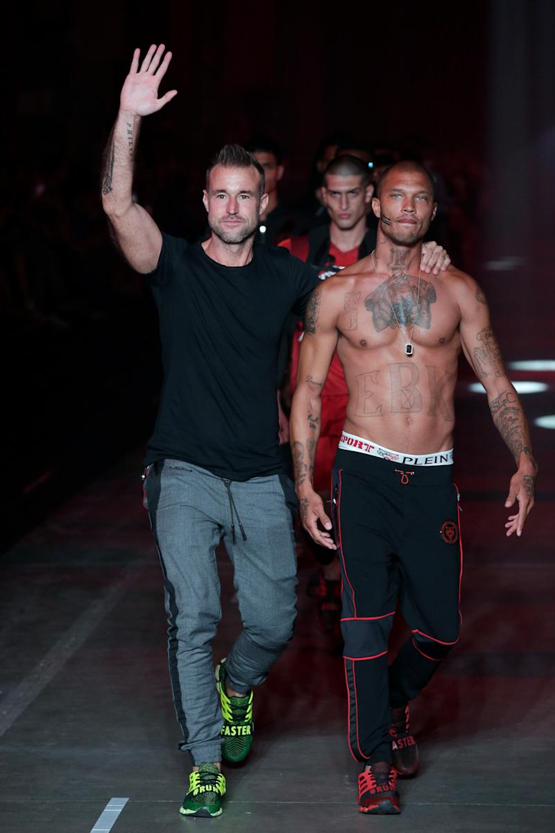 Philipp Plein and Jeremy Meeks walking the runway together.  (Sebastian Reuter via Getty Images)