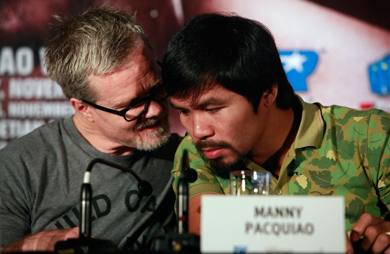 SHANGHAI, CHINA - JULY 31: Freddie Roach (L) and Manny Pacquiao (R) chat at a press conference on July 31, 2013 in Shanghai, China. (Photo by Kevin Lee/Getty Images)