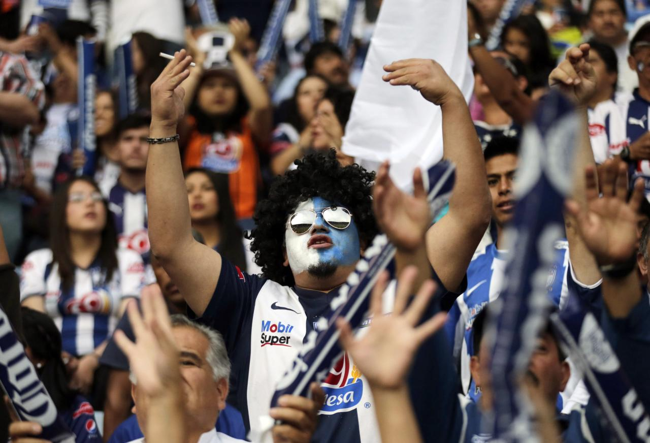 Fans of Pachuca cheer before their Mexican league championship final soccer match against Leon at the Hidalgo stadium in Pachuca May 18, 2014. REUTERS/Henry Romero (MEXICO - Tags: SPORT SOCCER)