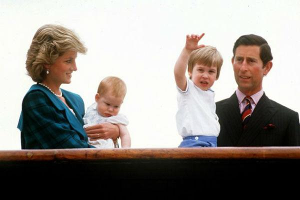 Diana holds baby Harry with Prince Charles and William in Venice in 1985.