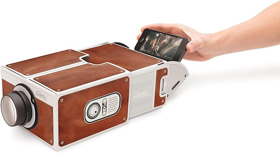 <p>Take watching movies on your phone to a whole new level with this <span>Smartphone Projector 2.0</span> ($29).</p>
