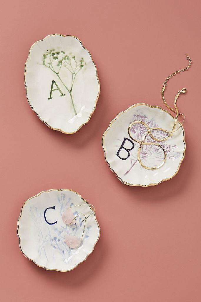 """<p><strong>Anthropologie</strong></p><p>anthropologie.com</p><p><strong>$14.00</strong></p><p><a href=""""https://go.redirectingat.com?id=74968X1596630&url=https%3A%2F%2Fwww.anthropologie.com%2Fshop%2Fbotanical-monogram-trinket-dish&sref=https%3A%2F%2Fwww.seventeen.com%2Ffashion%2Fg34728590%2Fanthropologie-2020-black-friday-sale%2F"""" rel=""""nofollow noopener"""" target=""""_blank"""" data-ylk=""""slk:Shop Now"""" class=""""link rapid-noclick-resp"""">Shop Now</a></p><p>A holiday gift under $15? I'll take five.</p>"""