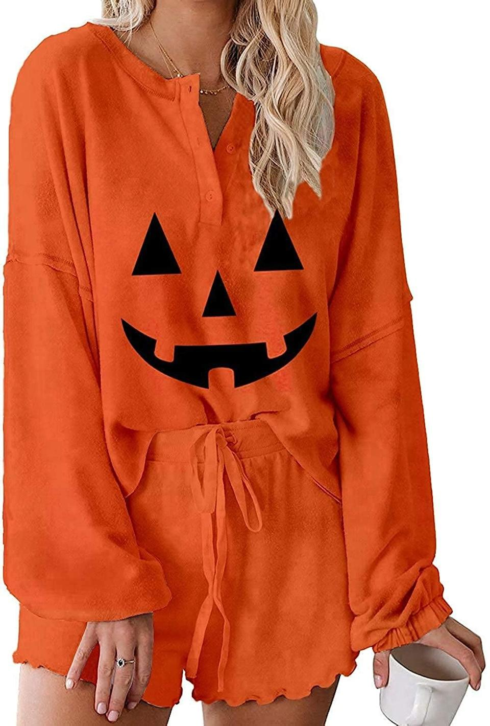 <p>The <span>Women's Jack-o-Lantern Printed Ruffle Short Pajamas Set</span> ($38, originally $40) is a soft and comfortable find that's perfect for those who love to embrace bold colors. The set is loose fitting with a long sleeve top and adjustable shorts.</p>