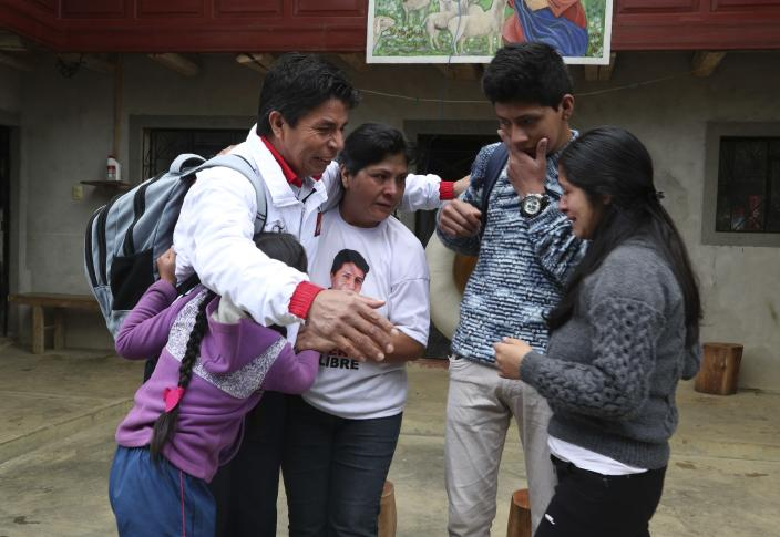 Free Peru party presidential candidate Pedro Castillo embraces his family before leaving his home to prepare for his electoral campaign, in Chugur, Peru, Friday, April 16, 2021. Castillo, a rural teacher, who has proposed rewriting Peru's constitution and deporting all immigrants living in the country illegally who commit crimes, will face rival candidate Keiko Fujimori in the June 6 presidential run-off election. (AP Photo/Martin Mejia)