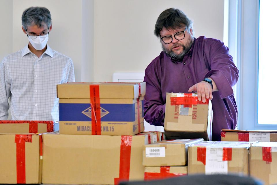 <p>File image: Election auditors Harri Hursti, right, and Mark Lindeman, catalog ballot boxes in Pembroke, New Hampshire, during a forensic audit of the 2020 New Hampshire legislative election. Auditors have found no evidence of fraud or political bias in the controversial New Hampshire election that has drawn the interest of Donald Trump</p> (AP)
