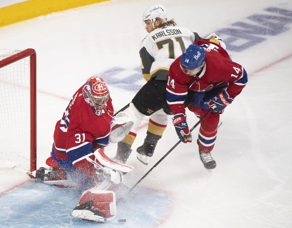 Montreal Canadiens goaltender Carey Price stops Vegas Golden Knights' William Karlsson (71) as Canadiens' Nick Suzuki defends during the third period of Game 3 of an NHL hockey semifinal series, Friday, June 18, 2021, in Montreal. (Paul Chiasson/The Canadian Press via AP)