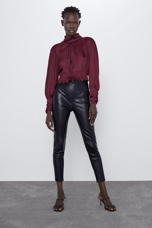 """<p><strong>The look:</strong> <a href=""""https://www.popsugar.com/buy/Buttoned-Faux-Leather-Leggings-508212?p_name=Buttoned%20Faux%20Leather%20Leggings&retailer=zara.com&pid=508212&price=36&evar1=fab%3Aus&evar9=38443987&evar98=https%3A%2F%2Fwww.popsugar.com%2Ffashion%2Fphoto-gallery%2F38443987%2Fimage%2F42270955%2FSandy-From-Grease&list1=shopping%2Cfall%20fashion%2Challoween%2Czara%2Challoween%20costumes%2Cdiy%20costumes%2Ceasy%20costumes&prop13=mobile&pdata=1"""" rel=""""nofollow"""" data-shoppable-link=""""1"""" target=""""_blank"""" class=""""ga-track"""" data-ga-category=""""Related"""" data-ga-label=""""https://www.zara.com/us/en/buttoned-faux-leather-leggings-p09640238.html?v1=31147329&amp;v2=1281566"""" data-ga-action=""""In-Line Links"""">Buttoned Faux Leather Leggings</a> ($36)<br> <strong>Pair it with:</strong> A black off-the-shoulder tee and sky-high red heels</p>"""