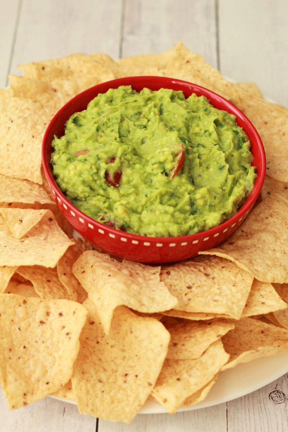 "<p>Set out a (big) bowl of this creamy, tangy, fresh dip as an appetizer while you work on the main dishes. We promise no one will mind if dinner's a little late. </p><p><a href=""https://lovingitvegan.com/simple-guacamole-recipe/"" rel=""nofollow noopener"" target=""_blank"" data-ylk=""slk:Get the recipe from Loving It Vegan »"" class=""link rapid-noclick-resp""><em>Get the recipe from Loving It Vegan »</em></a></p>"
