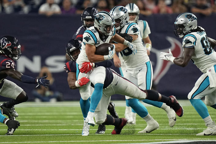 Carolina Panthers running back Christian McCaffrey (22) is tackled by Houston Texans' Paul Quessenberry during the first half of an NFL football game Thursday, Sept. 23, 2021, in Houston. (AP Photo/Eric Christian Smith)