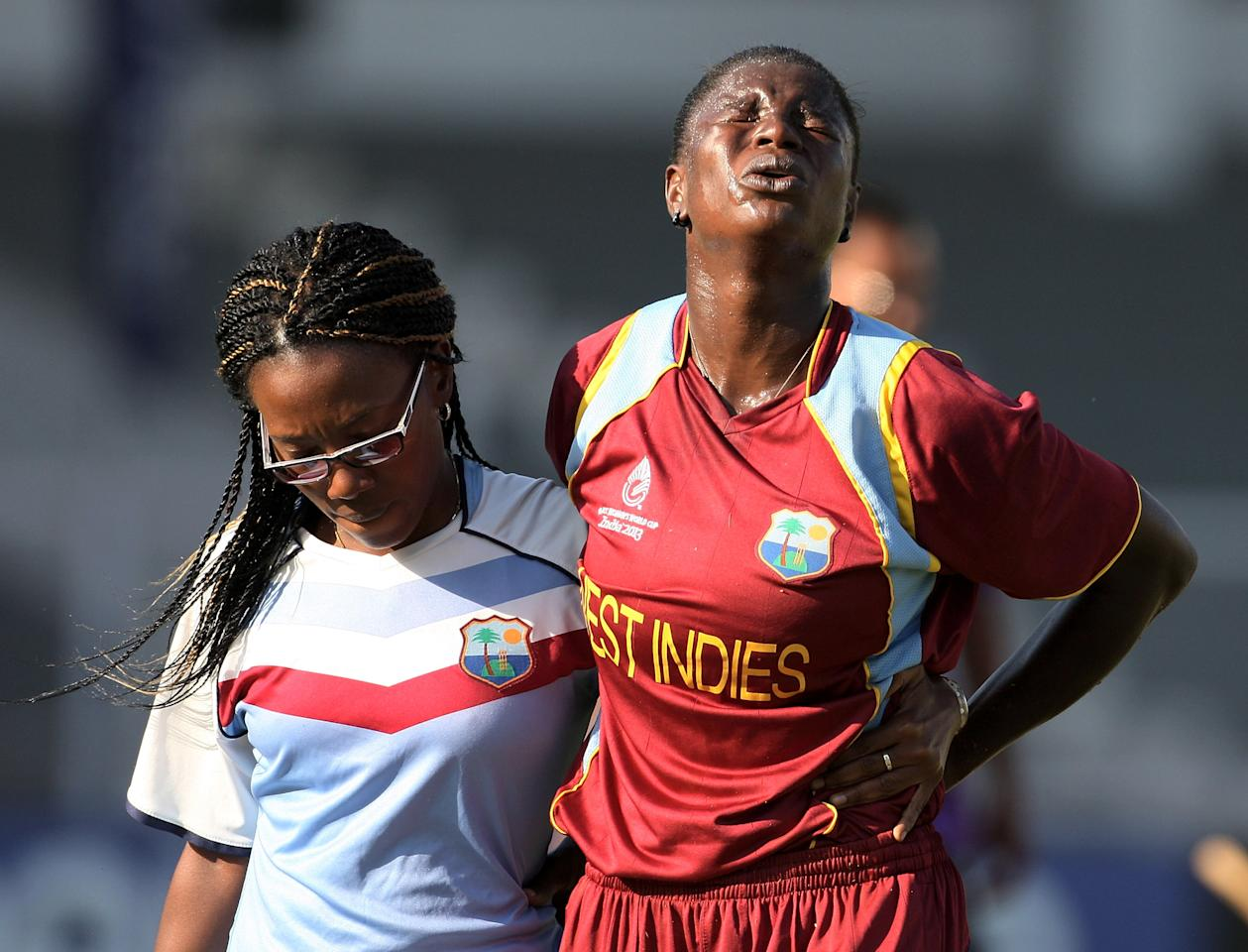 MUMBAI, INDIA - FEBRUARY 17: Tremayne Smartt of West Indies after injuring her back leaves the field during the final between Australia and West Indies of the Women's World Cup India 2013 played at the Cricket Club of India ground on February 17, 2013 in Mumbai, India. (Photo by Graham Crouch/ICC via Getty Images)