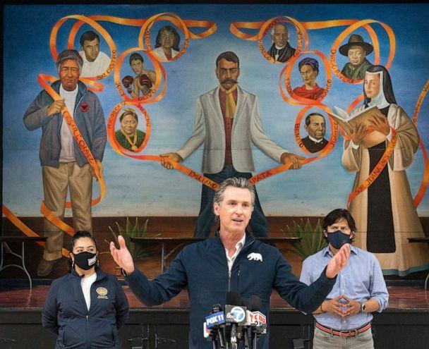 PHOTO: California Gov. Gavin Newsom, center visits the Ramona Gardens Recreation Center in Los Angeles to discuss the state's efforts to vaccinate hard-to-reach and disproportionately impacted communities in Los Angeles Sunday, Feb. 21, 2021.  (Damian Dovarganes/AP)