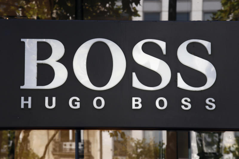 The logo of Hugo Boss, a German luxury fashion house is pictured on the Champs Elysees Avenue in Paris, France, Wednesday, Sept. 20, 2017. (AP Photo/Francois Mori)