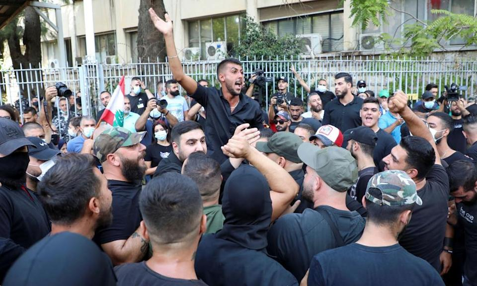 Protesters demand the removal of Tarek Bitar, the lead judge of the port blast investigation, near the justice palace in Beirut.