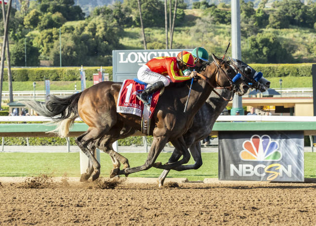 In a photo provided by Benoit Photo, Gift Box and jockey Joel Rosario, iniside, outleg McKinzie, outside, with Mike Smith, to win the Grade I, $600,000 Santa Anita Handicap horse race Saturday, April 6, 2019 ,at Santa Anita in Arcadia, Calif. (Benoit Photo via AP)