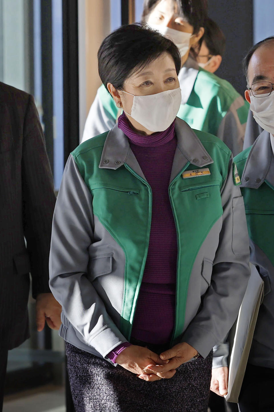 "Tokyo Gov. Yuriko Koike prepares to meet Japan's Economy Minister Yasutoshi Nishimura in Tokyo Saturday, Jan. 2, 2021. Japan's capital of Tokyo and three nearby prefectures asked the national government Saturday to declare a ""state of emergency"" to curtail the surging spread of the coronavirus pandemic. (Jun Hirata/Kyodo News via AP)"