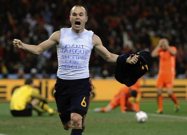 FILE - In this July 11, 2010 file photo, Spain's Andres Iniesta celebrates after scoring the only goal in the World Cup final soccer match against the Netherlands at Soccer City in Johannesburg, South Africa. The 21st World Cup begins on Thursday, June 14, 2018, when host Russia takes on Saudi Arabia. (AP Photo/Martin Meissner, File)