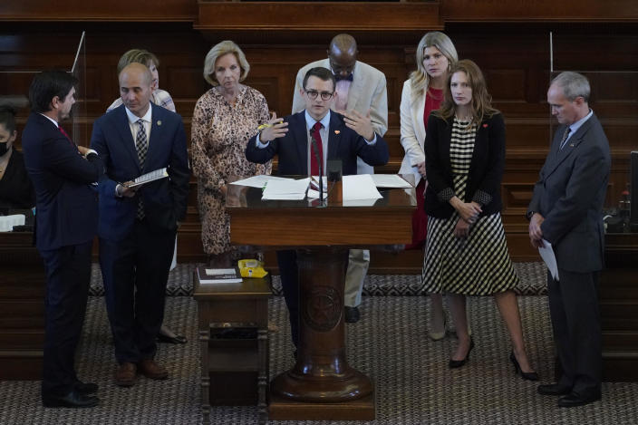 Representative Briscoe Cain, R-Houston, center, stands with co-sponsors as he answers questions and speaks in favor an election bill in the House Chamber at the Texas Capitol in Austin on May 6, 2021. / Credit: Eric Gay / AP