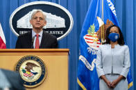 Attorney General Merrick Garland, accompanied by Assistant Attorney General for Civil Rights Kristen Clarke, right, speaks at a news conference at the Department of Justice in Washington, Thursday, Aug. 5, 2021, to announce that the Department of Justice is opening an investigation into the city of Phoenix and the Phoenix Police Department. (AP Photo/Andrew Harnik)