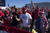 Supporters of President Donald Trump cheer as he arrives for a campaign rally at Laughlin/Bullhead International Airport, Wednesday, Oct. 28, 2020, in Bullhead City, Ariz. (AP Photo/Evan Vucci)