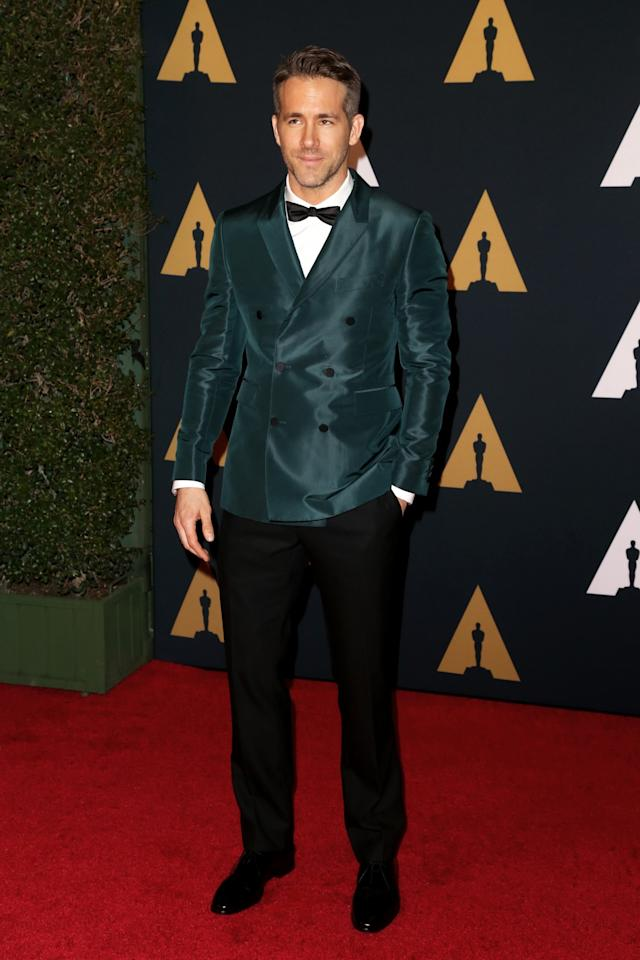 <p>Ryan Reynolds was extremely dapper in a green satin jacket and slim-fitting black trousers. <i>[Photo: Getty]</i> </p>