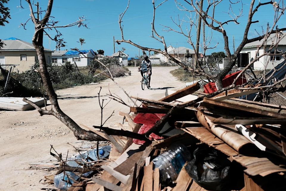 Debris from damaged homes lines a street on the nearly destroyed island of Barbuda on 8 December 2017 in Cordington, Barbuda. (Getty Images)