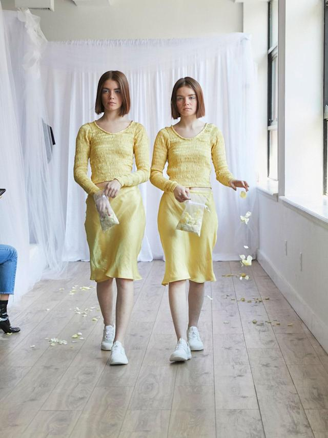 <p>Twin models in matching yellow dresses at the Collina Strada Fall/Winter 2018 show. (Photo: Jonathan Hokklo) </p>