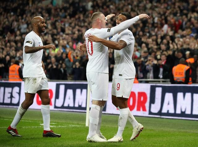 Rooney celebrates with goalscorer Callum Wilson