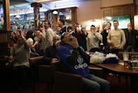 Britain Football Soccer - Leicester City fans watch the Chelsea v Tottenham Hotspur game in pub in Leicester - 2/5/16 Leicester City fans watching the game celebrate after Chelsea's first goal Reuters / Eddie Keogh Livepic