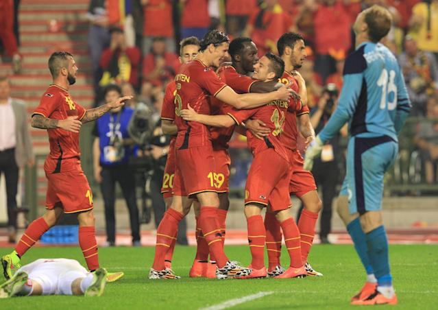 Belgium's Dries Mertens, right, gets congratulations by his team after he scored during a friendly soccer match against Tunisia, at the King Baudouin stadium in Brussels, Saturday, June 7, 2014. Belgium will play against South Korea, Russia and Algeria in Group H of the World Cup 2014 in Brazil. (AP Photo/Yves Logghe)