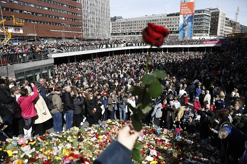People attend a memorial ceremony at Sergels Torg plaza in Stockholm (AFP Photo/Odd ANDERSEN)