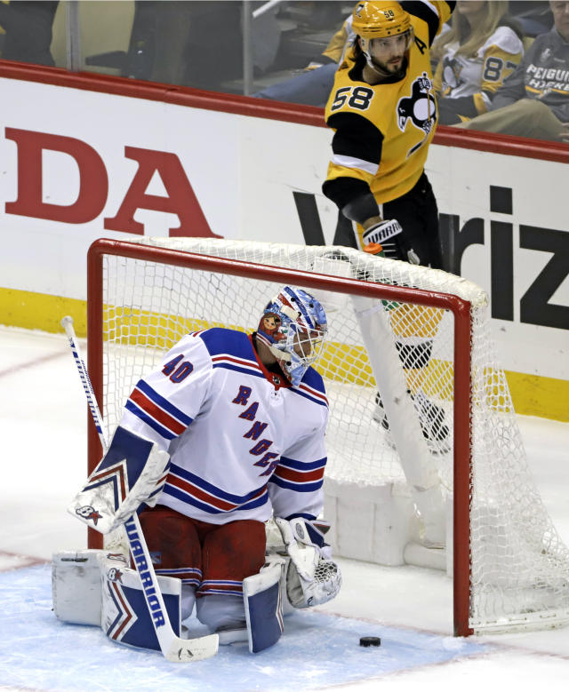 Pittsburgh Penguins' Kris Letang (58) celebrates his goal against New York Rangers' Alexandar Georgiev (40) during the first period of an NHL hockey game in Pittsburgh, Sunday, Feb. 17, 2019. (AP Photo/Gene J. Puskar)