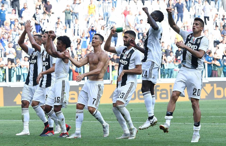 Juventus' Cristiano Ronaldo, 4th from left, and temmates celebrate their 2-1 win over Sassuolo, at the end of a Serie A soccer match between Juventus and Sassuolo, at the Allianz Stadium in Turin, Italy, Sunday, Sept. 16, 2018. (Andrea Di Marco/ANSA via AP)