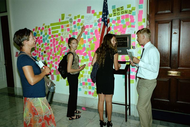 Visitors are constantly outside of her office, hoping to catch a glimpse of the congresswoman. They also leave messages on Post-It notes.