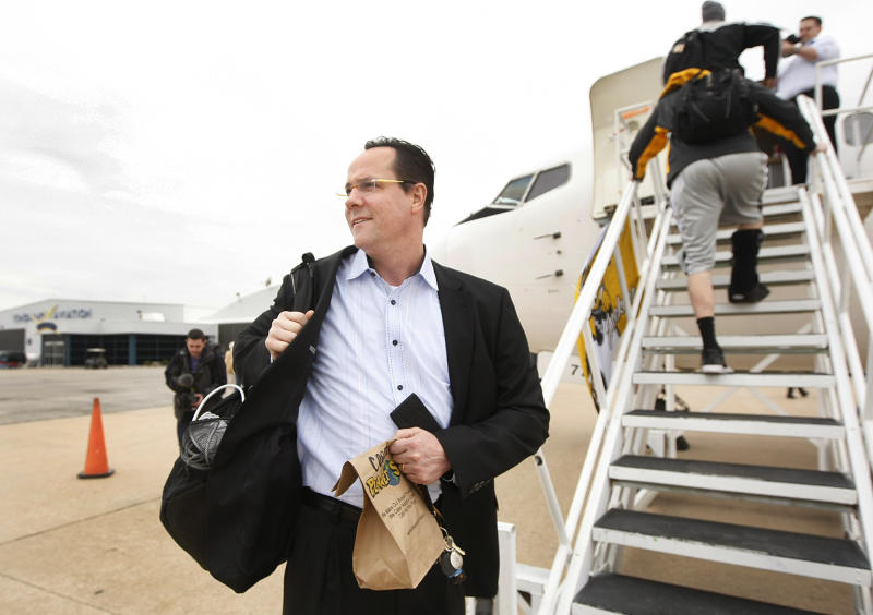 Wichita State coach Gregg Marshall greets fans outside Yingling Aviation in Wichita, Kan., Wednesday, April 3, 2013, as he gets ready to board a charter flight to Atlanta where the Shockers will play in the NCAA college basketball tournament's Final Four. (AP Photo/The Wichita Eagle, Fernando Salazar) LOCAL TV OUT; MAGS OUT; LOCAL RADIO OUT; LOCAL INTERNET OUT