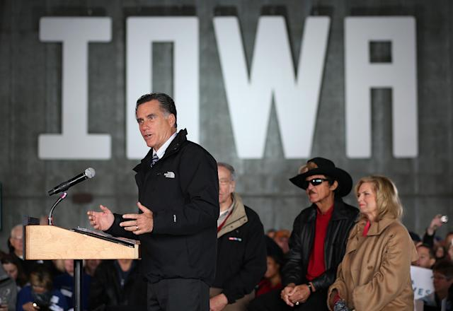 DUBUQUE, IA - NOVEMBER 03: Republican presidential candidate, former Massachusetts Gov. Mitt Romney speaks during a campaign rally at Dubuque Jet Center as his wife Ann Romney and former NASCAR driver Richard Petty listen on November 3, 2012 in Dubuque, Iowa. With less than a week before election day, Romney is campaigning in battleground states across the country. (Photo by Justin Sullivan/Getty Images)